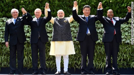 Brazilian President Michel Temer, Russian President Vladimir Putin, Indian Prime Minister Narendra Modi, Chinese President Xi Jinping and South African President Jacob Zuma pose for a group photo during the BRICS Summit in Goa.