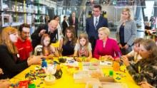 "Melania Trump, seated fourth from left, plays with children during a visit to the Copernicus Science Centre in Warsaw, Poland, on Thursday, July 6. She was joined by Polish first lady Agata Kornhauser-Duda, who is in the pink jacket. The Trumps <a href=""http://www.cnn.com/2017/07/06/politics/gallery/trump-poland-germany/index.html"" target=""_blank"">were visiting Poland</a> ahead of a G20 summit in Germany."