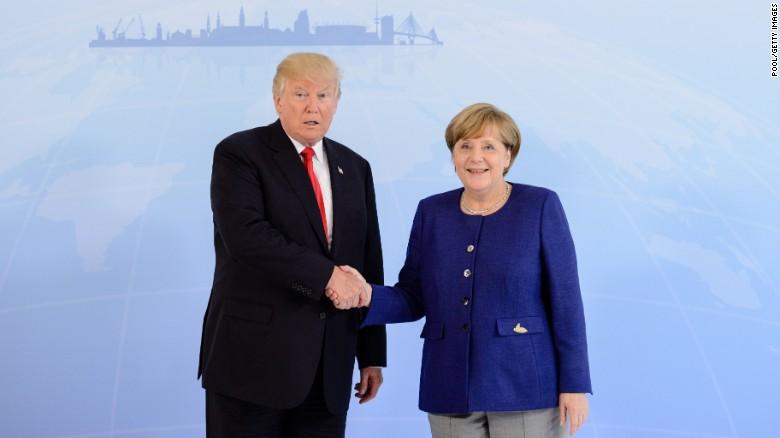 Trump Merkel begin visit with handshake