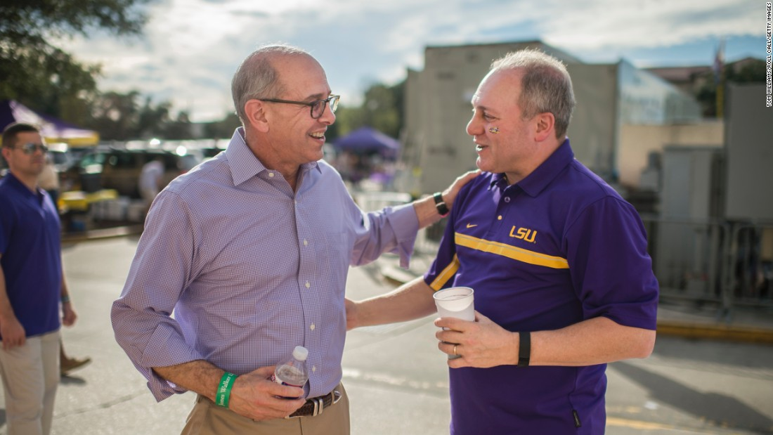 Scalise talks with US Rep. Charles Boustany before a Louisiana State football game in November. Scalise is an LSU alumnus.
