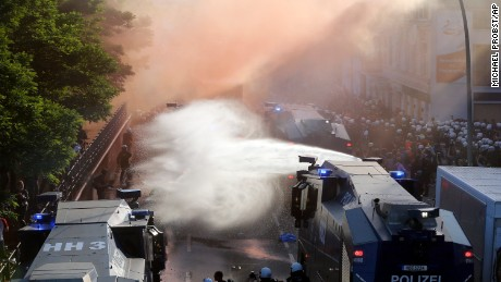 Police uses water canons during a protest against the G-20 summit in Hamburg, northern Germany, Thursday, July 6, 2017. The leaders of the group of 20 meet July 7 and 8. (AP Photo/Michael Probst)