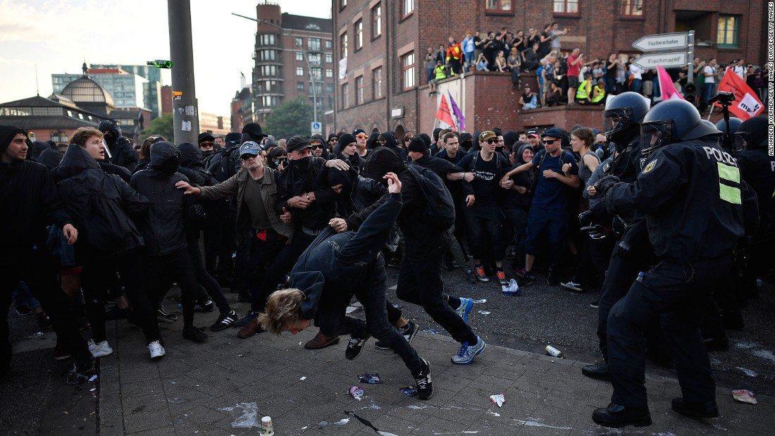 Protesters clash with riot police. The protest escalated throughout the day and evening.