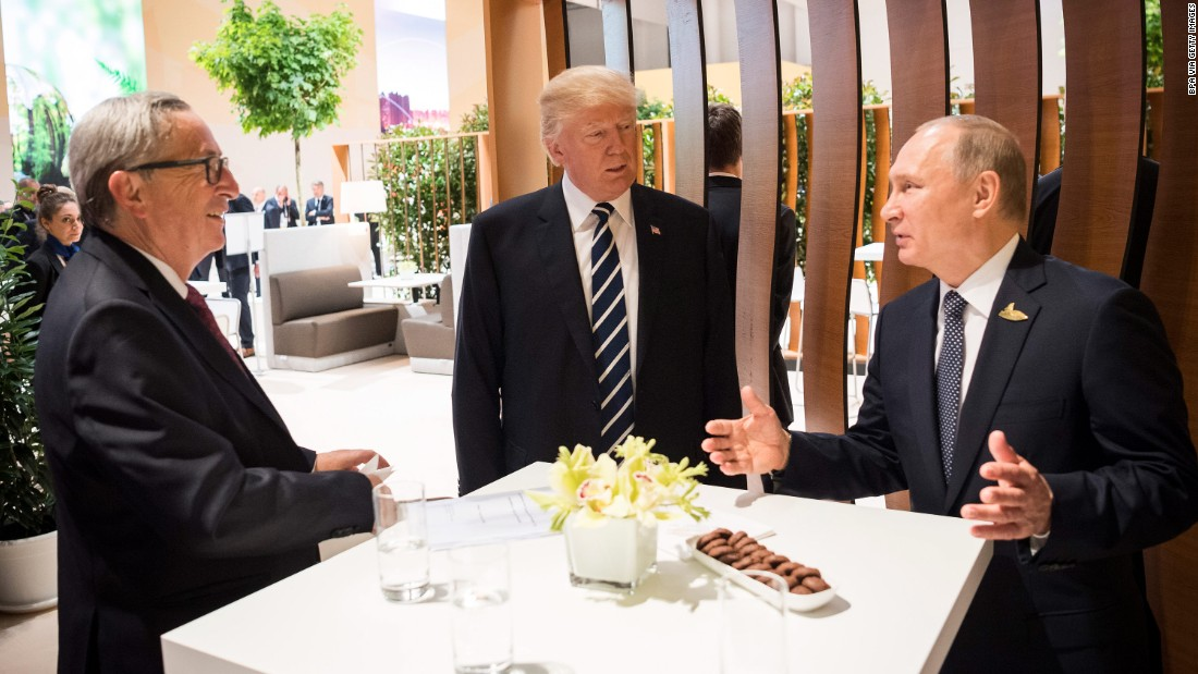 Trump stands with Putin and European Commission President Jean-Claude Juncker, left, at the G20 summit. Climate change, terrorism and migration are on the agenda.