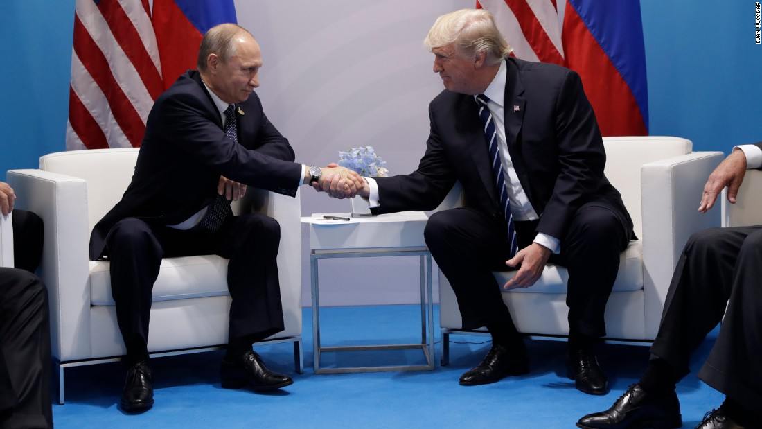 "Trump shakes hands with Putin as <a href=""http://www.cnn.com/2017/07/07/politics/trump-putin-meeting/index.html"" target=""_blank"">they meet on the sidelines</a> of the summit. They talked for more than two hours, discussing interference in US elections and ending with an agreement on curbing violence in Syria."