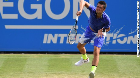 Tomic serves at the Aegon International Eastbourne in England, June 2017.