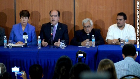 "The president of Venezuela's National Assembly, Julio Borges (C), accompanied by University governors and members of the opposition coalition Democratic Unity Roundtable (MUD) offer a press conference in Caracas on July 7, 2017. Venezuela's Catholic Church said Friday that constitutional reforms planned by the country's leftist government in response to a deadly political crisis were turning the country into a ""military dictatorship."" / AFP PHOTO / FEDERICO PARRA        (Photo credit should read FEDERICO PARRA/AFP/Getty Images)"