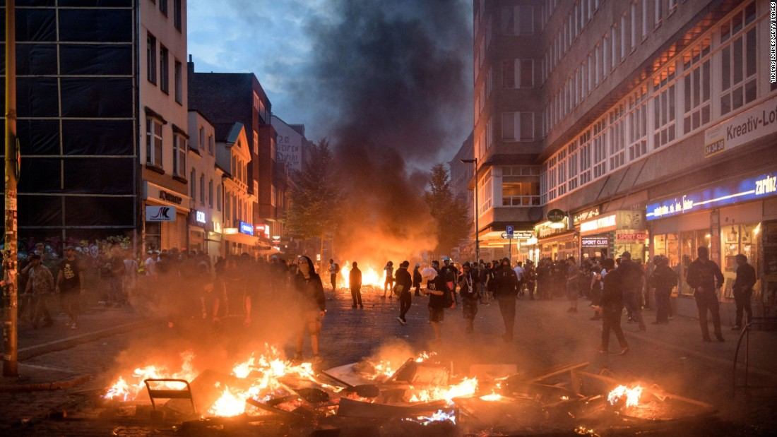 Protesters gather near a burning barrier during a demonstration against the G20 summit on Friday, July 7, in Hamburg, Germany. Protesters clashed with authorities as world leaders gathered for the two-day economic summit.