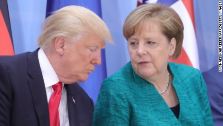 President Donald Trump and German Chancellor Angela Merkel attend a panel discussion Saturday.