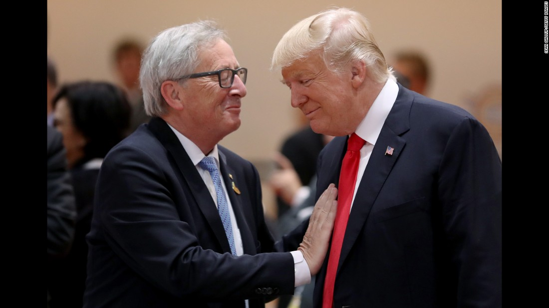 European Commission President Jean-Claude Juncker and Trump chat before the morning working session July 8.