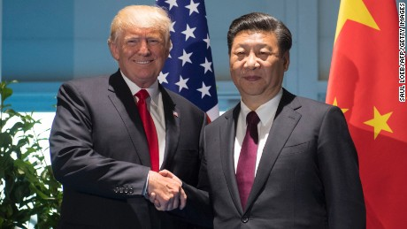 US President Donald Trump and Chinese President Xi Jinping (R) shake hands prior to a meeting on the sidelines of the G20 Summit.
