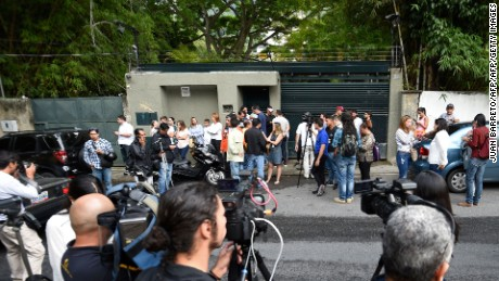 "Journalists and supporters of Venezuelan opposition leader Leopoldo Lopez gather outside his house in Caracas, after he was released from prison and placed under house arrest for health reasons, on July 8, 2017. Venezuela's Supreme Court confirmed on its Twitter account it had ordered Lopez to be moved to house arrest, calling it a ""humanitarian measure"" granted on July 7 by the court's president Maikel Moreno. ""Leopoldo Lopez is at his home in Caracas with (wife) Lilian and his children,"" Lopez's Spanish lawyer Javier Cremades said in Madrid. ""He is not yet free but under house arrest. He was released at dawn."" / AFP PHOTO / Juan BARRETO        (Photo credit should read JUAN BARRETO/AFP/Getty Images)"