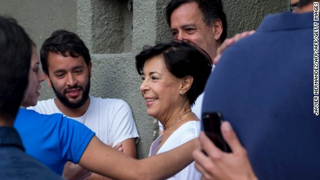 "Antonieta Mendoza (C), mother of Venezuelan opposition leader Leopoldo Lopez, arrives at his house in Caracas, after he was released from prison and placed under house arrest for health reasons, on July 8, 2017. Venezuela's Supreme Court confirmed on its Twitter account it had ordered Lopez to be moved to house arrest, calling it a ""humanitarian measure"" granted on July 7 by the court's president Maikel Moreno. ""Leopoldo Lopez is at his home in Caracas with (wife) Lilian and his children,"" Lopez's Spanish lawyer Javier Cremades said in Madrid. ""He is not yet free but under house arrest. He was released at dawn."" / AFP PHOTO / JAVIER HERNANDEZ        (Photo credit should read JAVIER HERNANDEZ/AFP/Getty Images)"