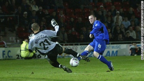 Rooney scoring for Everton as a teenager in 2002.