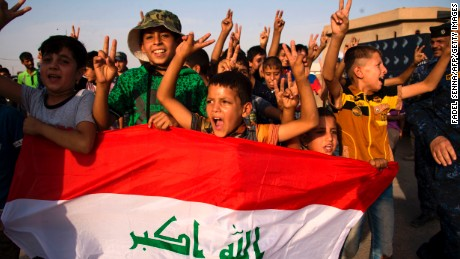 "children holding Iraq's national flag react as Iraqi forces celebrate in the Old City of Mosul on July 9, 2017 after the government's announcement of the ""liberation"" of the embattled city.  Iraq declared victory against the Islamic State group in Mosul on July 9 after a gruelling months-long campaign, dealing the biggest defeat yet to the jihadist group. / AFP PHOTO / FADEL SENNA        (Photo credit should read FADEL SENNA/AFP/Getty Images)"