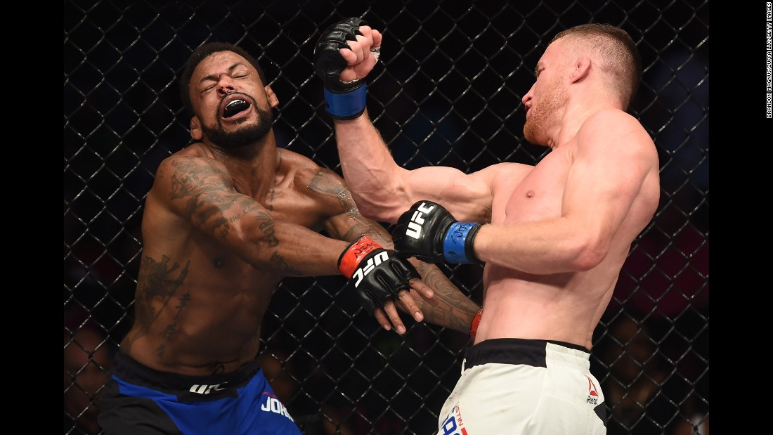 UFC fighter Justin Gaethje punches Michael Johnson during their lightweight bout in Las Vegas on Friday, July 7. Gaethje stopped Johnson late in the second round.