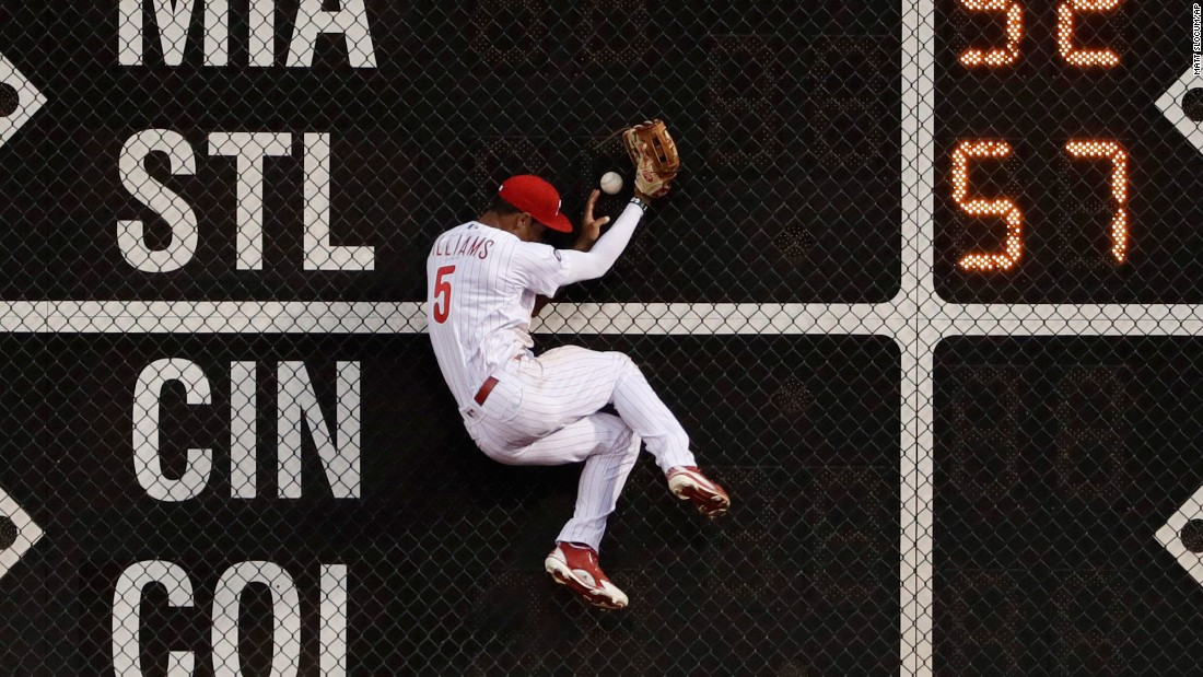 Philadelphia left fielder Nick Williams crashes into the wall as he tries to make a catch against Pittsburgh on Wednesday, July 5.