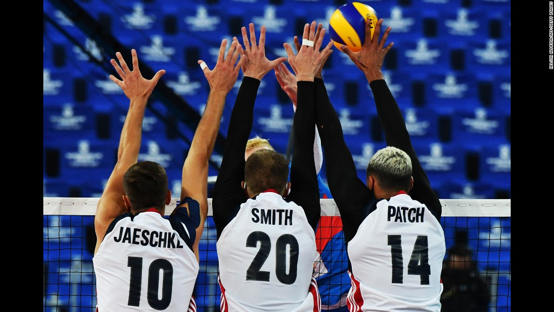 From left, Americans Tom Jaeschke, David Smith and Ben Patch block a Serbian player's spike during a World League volleyball match on Wednesday, July 5. The United States advanced to the semifinals of the tournament but fell short to hosts Brazil.