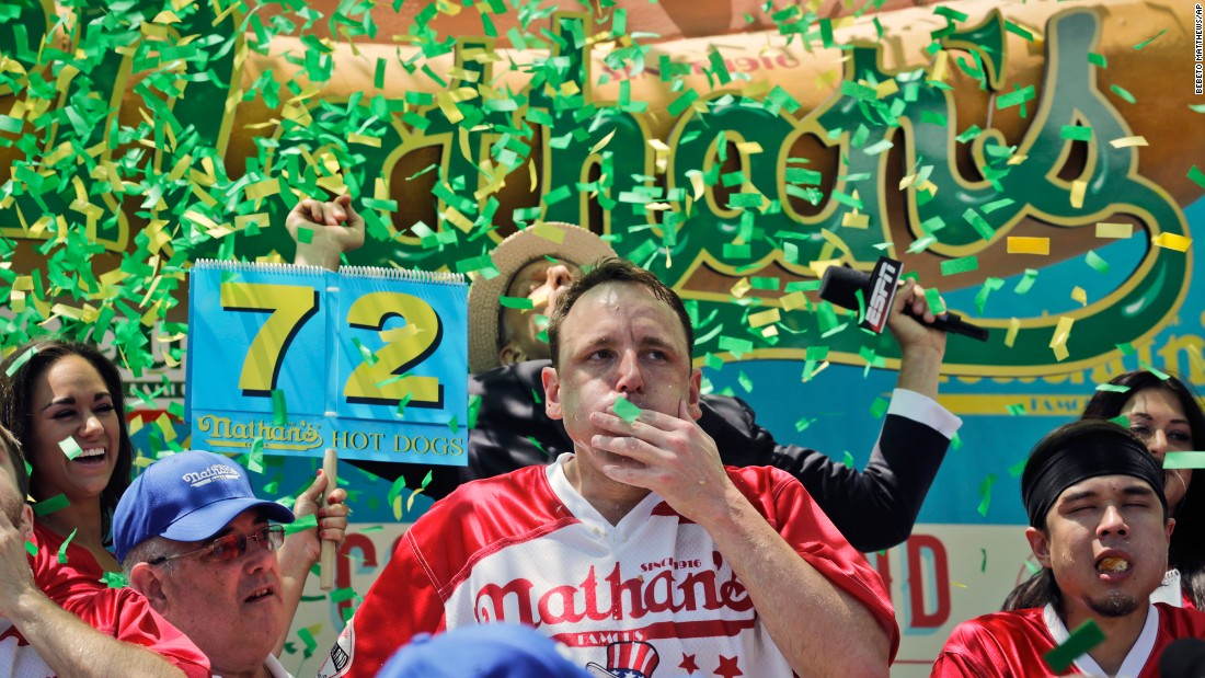 "Competitive eater Joey Chestnut, center, takes part in Nathan's Hot Dog Eating Contest, which is held every Fourth of July in New York. He ate a record 72 hot dogs in 10 minutes, winning the competition for the 10th time in 11 years. <a href=""http://www.cnn.com/2017/07/03/sport/gallery/what-a-shot-sports-0703/index.html"" target=""_blank"">See 31 amazing sports photos from last week</a>"