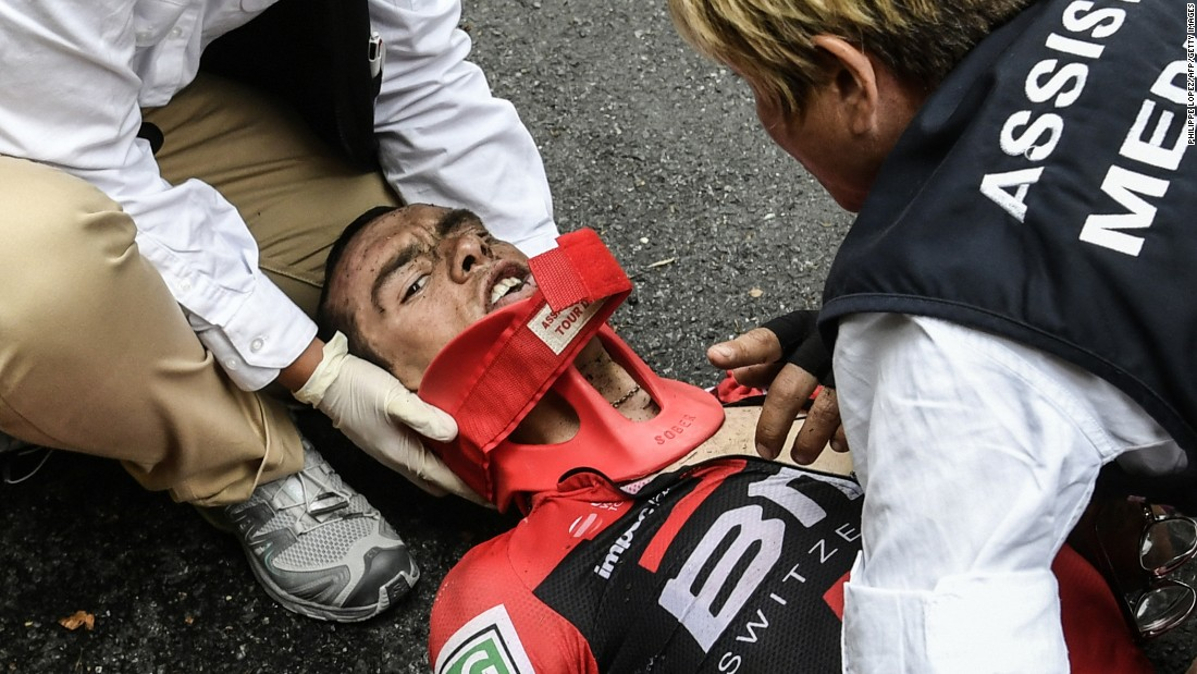 Richie Porte receives medical assistance after his horror crash during stage nine. The Aussie sustained a fractured right collarbone and pelvis on the descent of the Mont du Chat.
