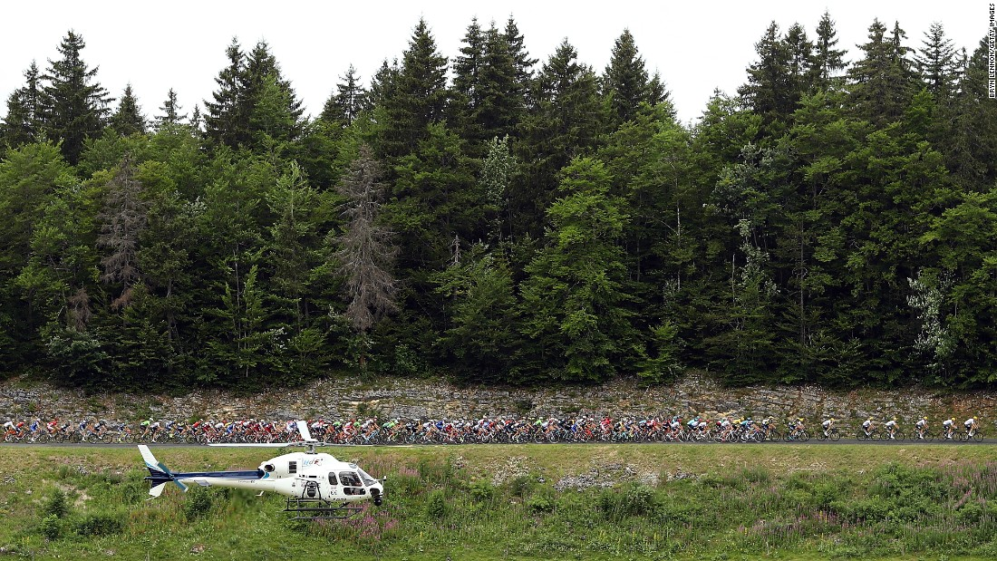The peloton rides past an emergency helicopter during stage nine.