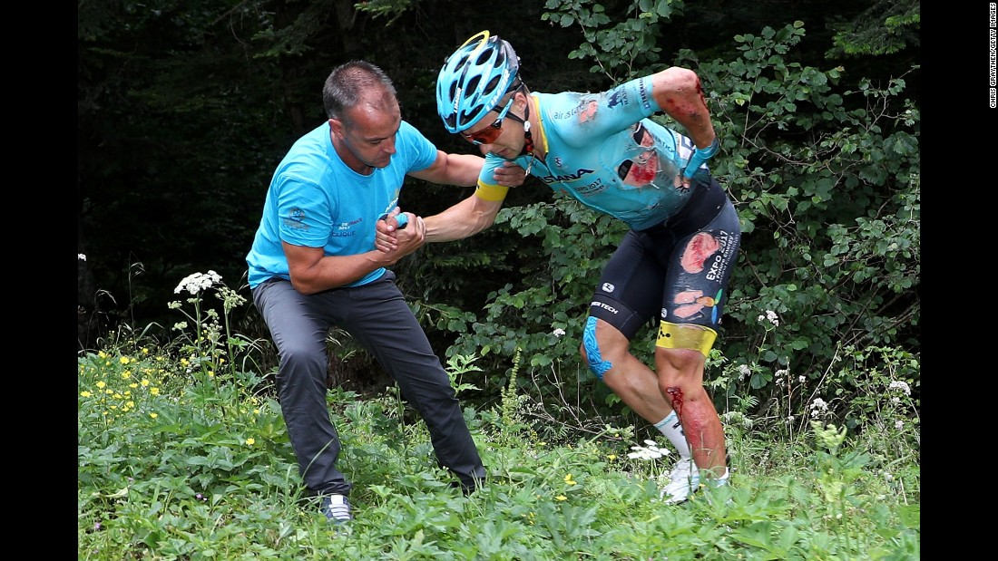 Team Astana's Alexey Lutsenko is helped from the bushes after crashing during stage nine from Nantua to Chambéry. The same corner claimed Lutsenko's teammate Bakhtiyar Kozhatayev as another victim, with Thomas suffering the same fate as the chasing pack arrived minutes later.