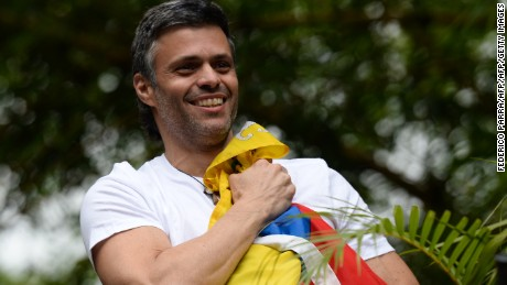 "Venezuelan opposition leader Leopoldo Lopez holds a Venezuelan national flag against his chest, as he greets supporters gathering outside his house in Caracas after he was released from prison and placed under house arrest for health reasons, on July 8, 2017. Venezuela's Supreme Court confirmed on its Twitter account it had ordered Lopez to be moved to house arrest, calling it a ""humanitarian measure"" granted on July 7 by the court's president Maikel Moreno. ""Leopoldo Lopez is at his home in Caracas with (wife) Lilian and his children,"" Lopez's Spanish lawyer Javier Cremades said in Madrid. ""He is not yet free but under house arrest. He was released at dawn."" / AFP PHOTO / Federico PARRA        (Photo credit should read FEDERICO PARRA/AFP/Getty Images)"