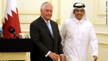 US Secretary of State Rex Tillerson and Qatari Foreign Minister Sheikh Mohammed bin Abdulrahman Al-Thani leave the stage following a press conference in Doha, on July 11, 2017. (STRINGER/AFP/Getty Images)