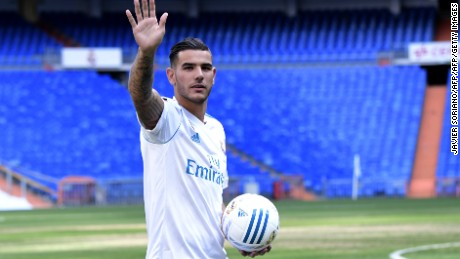 Real Madrid's French new player Theo Hernandez greets supporters during his presentation at the Santiago Bernabeu stadium in Madrid, on July 10, 2017. / AFP PHOTO / JAVIER SORIANO        (Photo credit should read JAVIER SORIANO/AFP/Getty Images)