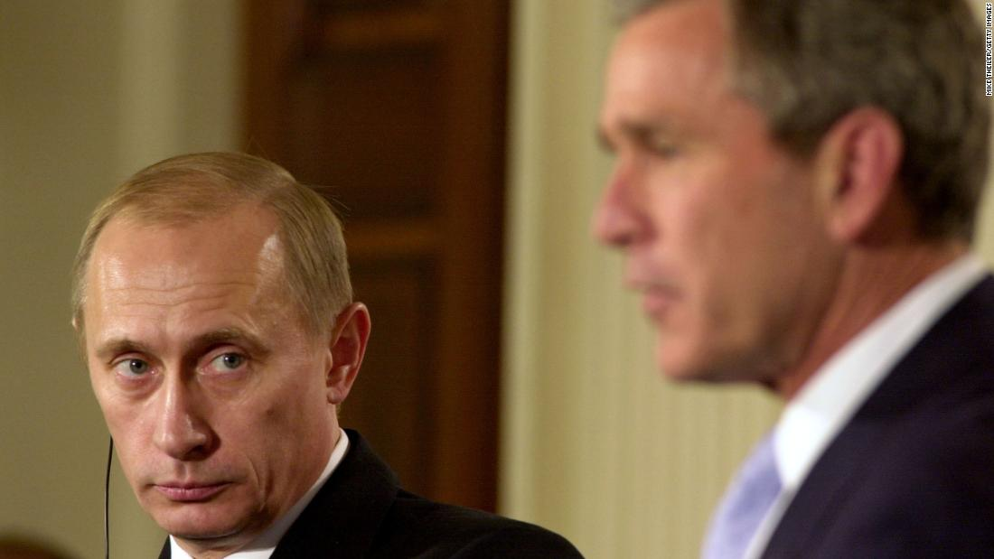 Putin listens to US President George W. Bush during a visit to the White House in November 2001. A few months later, the two signed a treaty to reduce and limit their strategic nuclear warheads.
