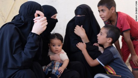 Wives of ISIS fighters and their children.