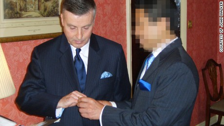John Walker and his then partner at their civil partnership ceremony in 2006. This image, obtained by CNN, was originally blurred by Walker in order to protect the identity of his husband.