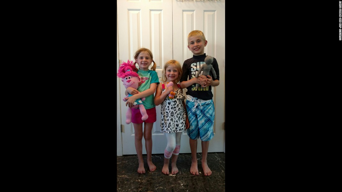 Evelyn Londt (1st grade), Isabella Londt (Kindergarten) and Oliver Londt (3rd grade) hold handmade toys from Ms. Trudy.