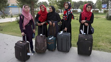Members of a female robotics team arrive from Herat province to receive visas from the U.S. embassy, at the Hamid Karzai International Airport, in Kabul, Afghanistan, Thursday, July 13, 2017.