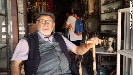 Ismet Sinaktas takes a rest outside an antiques shop in Ankara.