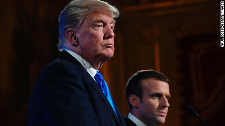 French President Emmanuel Macron and US President Donald Trump hold a press conference following meetings at the Elysee Palace in Paris, on July 13, 2017, during the US president's 24-hour trip that coincides with France's national day and the 100th anniversary of US involvement in World War I. Donald Trump arrived in Paris for a presidential visit filled with Bastille Day pomp and which the White House hopes will offer respite from rolling scandal backing home.