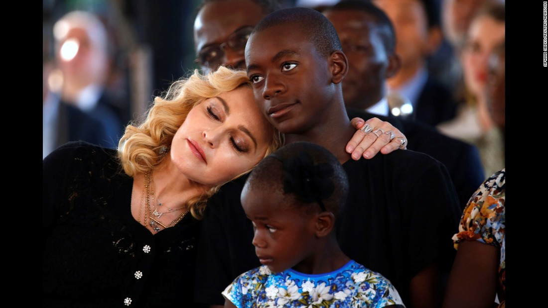 "Singer Madonna embraces her son, David Banda, at <a href=""http://www.cnn.com/2017/07/12/entertainment/madonna-surgery-center-malawi/index.html"" target=""_blank"">the opening of a children's hospital</a> in Blantyre, Malawi, on Tuesday, July 11. The hospital was funded by Madonna's Raising Malawi charity. Four of her six children -- including David and Stella, who is seen in the foreground -- were adopted from Malawi."