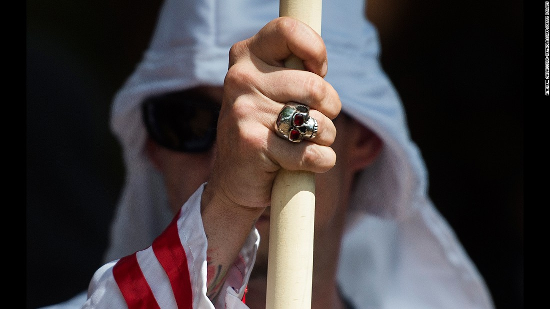 "A member of the Ku Klux Klan participates in a rally in Charlottesville, Virginia, on Saturday, July 8. About 50 Klan members and supporters <a href=""http://www.cnn.com/2017/07/08/us/kkk-rally-charlottesville-statues/index.html"" target=""_blank"">were protesting the city's plan</a> to remove a statue of Confederate Gen. Robert E. Lee from a park -- one of several steps the city is taking to reduce its number of Confederate monuments. Several hundred counterprotesters also showed up."