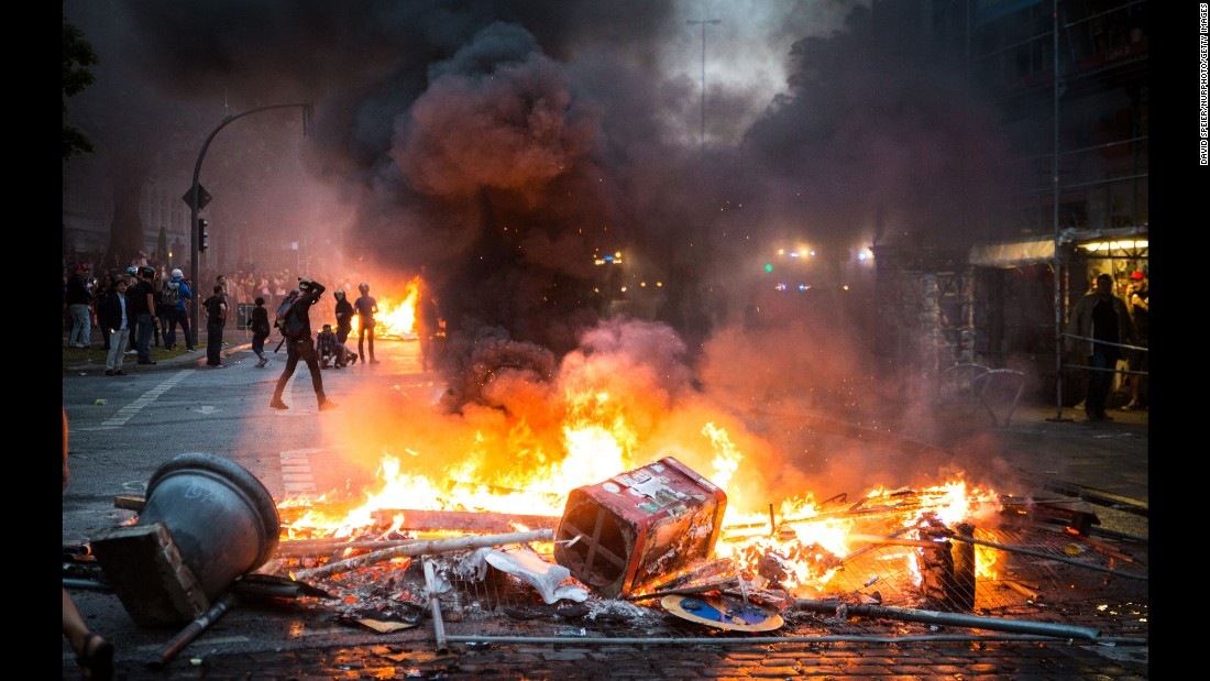 "Fire burns in a street as protesters clash with police in Hamburg, Germany, on Friday, July 7. Hundreds of police officers were injured in the clashes, which coincided with a G20 summit. <a href=""http://www.cnn.com/2017/07/08/europe/g20-protests/index.html"" target=""_blank"">Rallies, riots and raves: Hamburg's three days of G20 protests</a>"