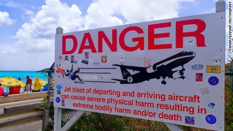 A sign near St. Maarten's Princess Juliana International Airport warns people about the danger from airplane jet engines.