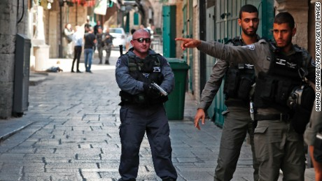 Israeli security forces stand guard at one of the entrances to Al Aqsa mosque compound in the Jerusalem's Old City on July 14, 2017, following an alleged attack. Three assailants opened fire on Israeli police in Jerusalem's Old City before fleeing to a nearby highly sensitive holy site and being killed by security forces, Israeli police said. / AFP PHOTO / Ahmad GHARABLI        (Photo credit should read AHMAD GHARABLI/AFP/Getty Images)