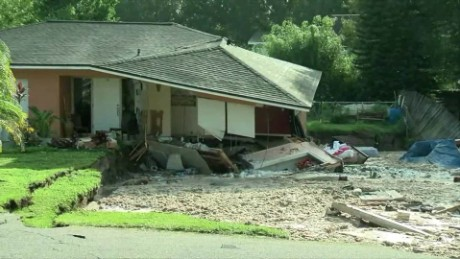 A house starts falling Friday into a sinkhole in Land O' Lakes, Florida.