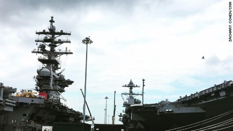 The USS Gerald Ford docked at Naval Station Norfolk next to the USS Dwight D. Eisenhower.