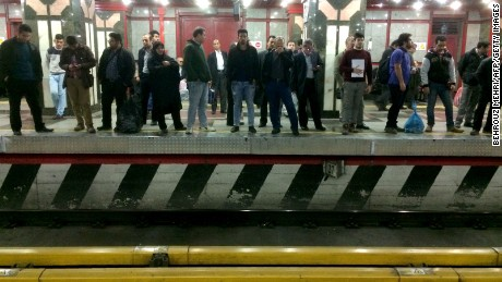 Iranians wait at a subway station in the capital, Tehran, in this file image from February 2016.