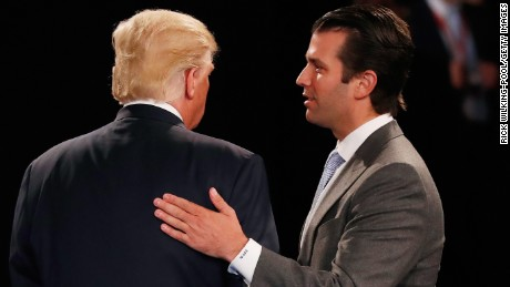 Donald Trump, Jr. (R) greets his father Republican presidential nominee Donald Trump during the town hall debate at Washington University on October 9 in St Louis, Missouri.