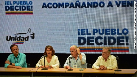 (L to R) Former Presidents Jorge Quiroga of Bolivia, Laura Chinchilla of Costa Rica , Andres Pastrana of Colombia and Miguel Angel Rodriguez of Costa Rica, observers to the opposition-organized vote to measure public support for Venezuelan President Nicolas Maduro's plan to rewrite the constitution, deliver a press conference in Caracas on July 16, 2017. Authorities have refused to greenlight the vote that has been presented as an act of civil disobedience and supporters of Maduro are boycotting it. Protests against Maduro since April 1 have brought thousands to the streets demanding elections, but has also left 96 people dead, according to an official toll.  / AFP PHOTO / RONALDO SCHEMIDT        (Photo credit should read RONALDO SCHEMIDT/AFP/Getty Images)