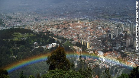 Panoramic view taken from the Cerro de Monserrate of a rainbow with city of Bogota in the background, in Colombia, on July 27, 2013. AFP PHOTO/Guillermo LEGARIA / AFP PHOTO / GUILLERMO LEGARIA        (Photo credit should read GUILLERMO LEGARIA/AFP/Getty Images)