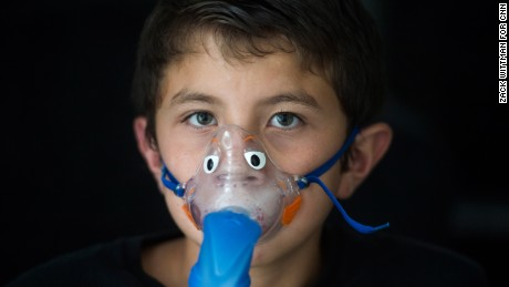 Alejandro Rodriguez poses for a portrait while wearing his nebulizer mask on Monday evening, May 22, 2017 at the Rodriguez's home in Greensboro, Florida. Alejandro suffers from asthma, and needs access to an inhaler and a nebulizer machine.