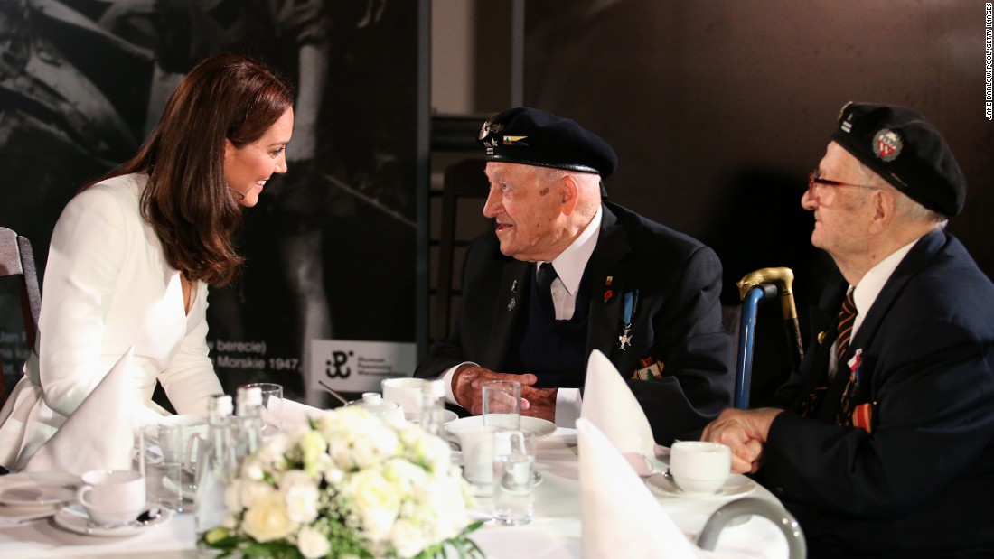 Kate speaks with a WWII veteran during a visit to the Warsaw Rising Museum on July 17, the first day of the British royal couple's official visit to Poland.