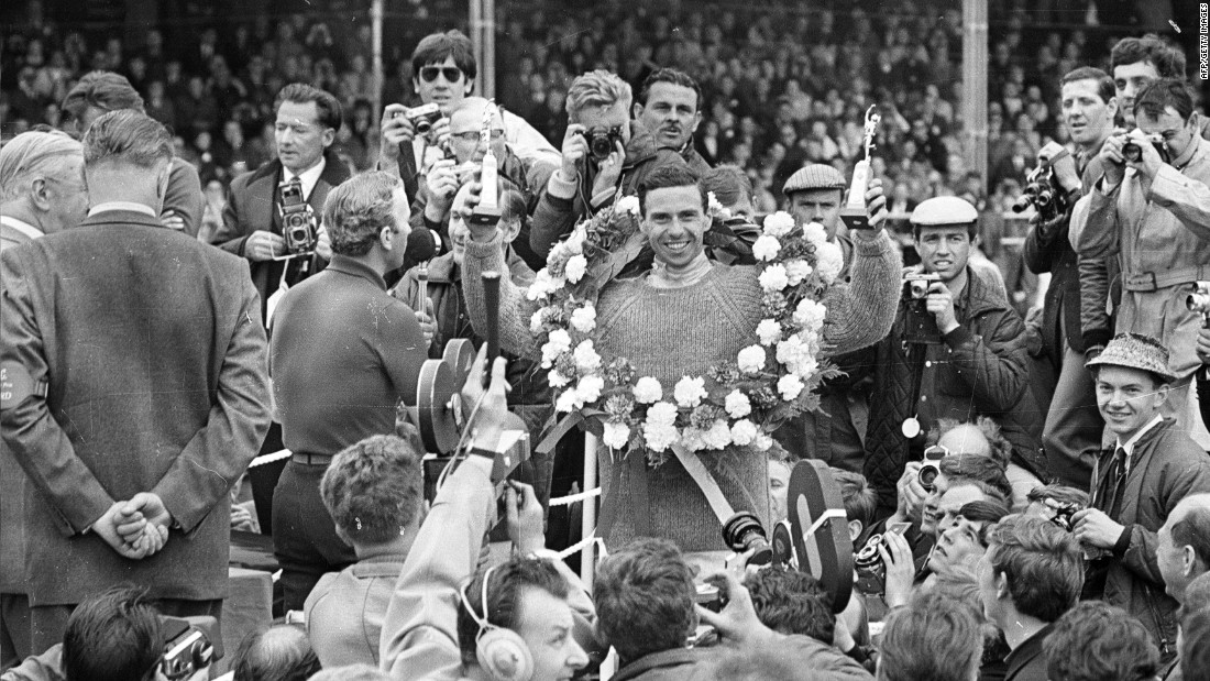 Briton Clark, pictured here celebrating his 1965 win at Silverstone, was one of F1's greatest drivers, winning the world title twice.
