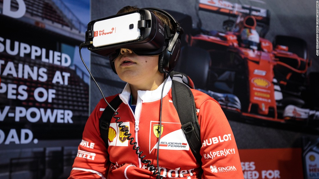 A young fan uses a virtual reality headset in the fan zone at Silverstone. F1's new owners have been revamping the attractions at race venues this season.